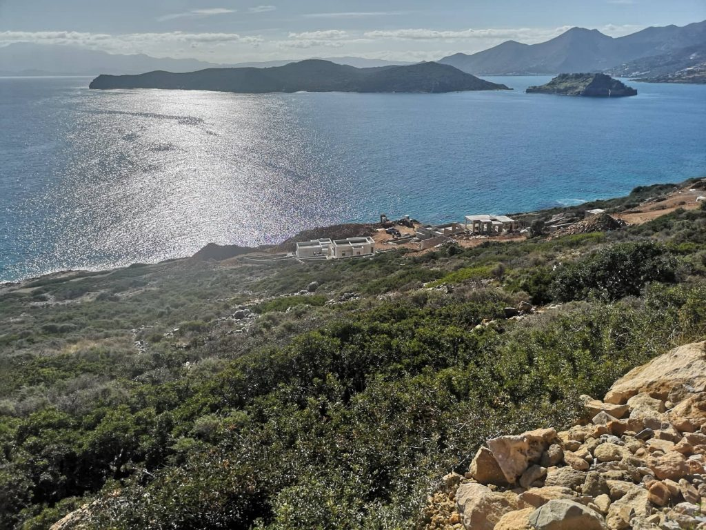 Seafront building plot with breathtaking views, northeast from Plaka, Elounda